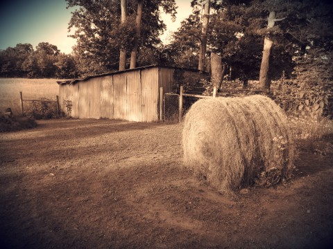 A Barn And A Hay Bale