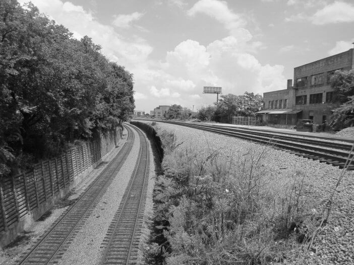 Dual Norfolk Southern and CSX line curving north to Downtown.